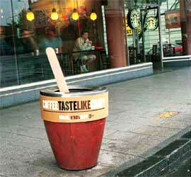 Coffee Taste Like Crap? Ad Firm Brands Garbage Cans Outside Competitor Shops