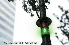 Tree-Wrapped Crossing Cues - The Wearable Signal Walking Sign Can be to Fastened to Any Shaft