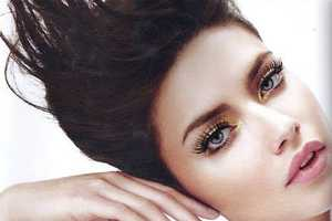 Adriana Lima Poses Pretty in Vogue Brazil February 2011