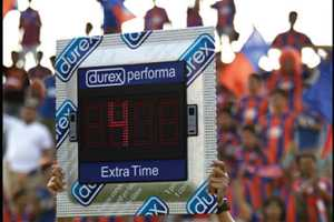 The Durex Performa Sign Markets to the Crowd During Half Time