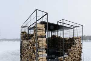 The Woodpile Cabin Makes You Stack Wood to Stay Warm