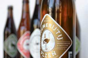 Brouwerij 't Ij Beer Features a Colorful Ostrich Insignia