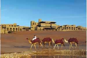 The Qasr Al Sarab Desert Resort Looks like a Magical Palace