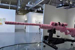 Monte A. Smith Creates a Crocheted Gun Store Art Installation