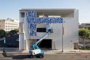 Artist RETNA Paints Mural for Museum of California Art Graffiti Series