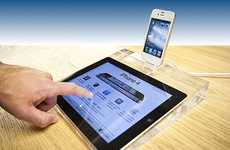 Translucent Tablet Holders - iPad 2 Display Dock is an Accessory Fit for a Fancy Store Display