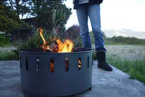 The Fire Ring Sets Aflame with Ease & Holds Your Drinks Conveniently