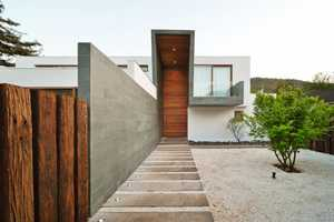 The 3 Element House Blends Rich Wood and Concrete Surfaces Magnificently