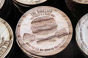 Oinkster Burger Nickels Make for Forest-Approved Marketing