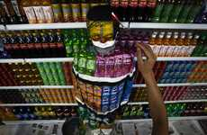 Liu Bolin's Plasticizer Project Blends Him into a Wall of Soda