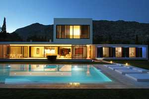 The Casa Bauza Uses Simple Designs to Complement the Environment