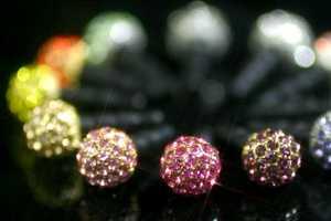 The Plug Apli Swarovski Ball Earphone Jack is Opulent