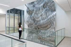 Draper by Rob Ley Passes Through Five Floors of a Building