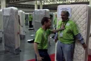 850 Human Mattress Dominoes Fall to Take Guinness Top Spot