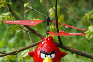 Harass Green and Yellow Pigs with the Angry Birds Helicopter