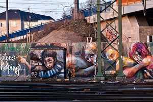 Artist Duo Herakut Sends a Meaningful Message Through Urban Art