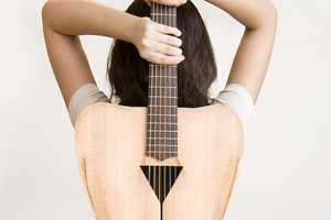 The 'Female Form 6 String Acoustic Guitar' is Curvy