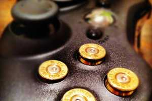 The Xbox 360 9mm Bullet Button Controller Draws Style from Shooters