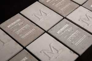 French Creative Agency Murmure Debuts Concrete Business Cards