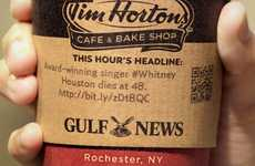 Press-Inspired Branding - Headline News Prints the Day's News on Coffee Sleeves to Gain Readers