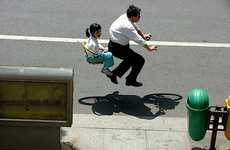 Hovering Civilian Cyclists - Floating Bike Photography by Zhao Huasen is Created Through Photoshop