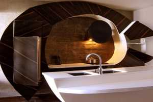 The Cassandra Cucine Curved Home is Extravagant