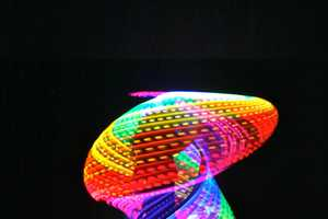 The Rechargeable Double Rainbow LED Hula Hoop Twinkles at Night