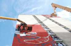 Sky-Scraping Mural Installments - The Shepard Fairey 'Street Art 13' Display is Dauntingly Huge