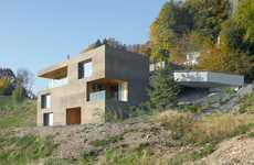 Boxy Integrated Mountain Havens - Ferienhaus Vitznau by Lischer Partner Blends Into its Surroundings