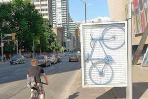 The cARTographyTO Street Art Hacks Into Sidewalk Ads