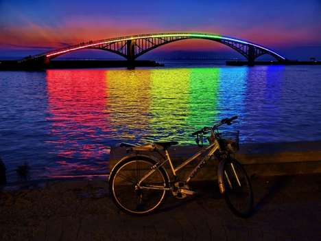 Colorfully Illuminated Overpasses - The Rainbow Bridge Glows Whimsically in the Night