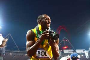 Usain Bolt Steals Camera from Cameraman and Takes his Own Shots