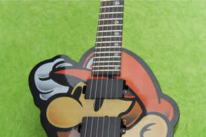 The Custom Super Mario Guitar Helps Save Virtual Worlds