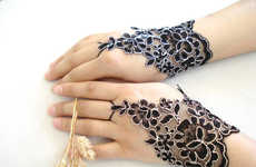 Exquisite Blossom-Inspired Gloves - These Bytugce Black Lace Accessories are Timeless