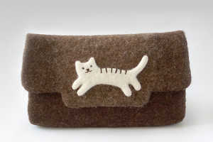 The Natural Felt Clutch Features a Cute Companion to Help You Shop
