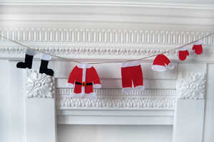 This Festive Christmas Garland Appears to Hold Santa's Clothing Out to Dry
