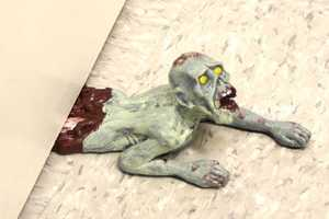 The Zombie Doorstop Struggles for Freedom, Leaving a Bloody Mess