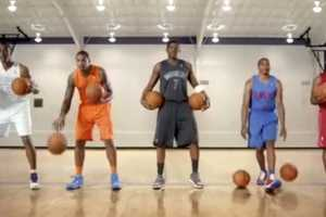 Players Dribble in Unison to Promote Christmas Day Uniforms