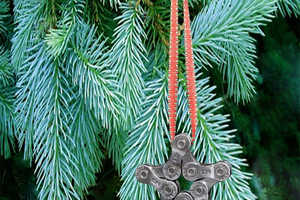 The Bike Chain Star Ornament is Made Out of Polished Salvaged Parts