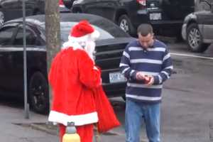 This Bad Santa Prank Involves Giving Out Bad Presents on the Street
