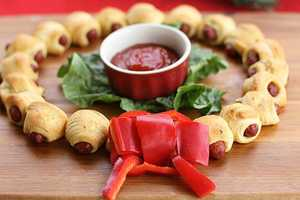 The Mini Crescent Dog Wreath Makes Pigs in a Blanket Festive