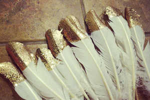 These Gold and Glitter Dipped Feathers are Perfect for New Year's Eve
