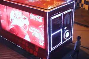 This Coca-Cola Christmas Truck Gives Away Free Holiday Decorations