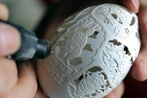 Artist's Egg Shell Carvings Display Traditional Chinese Landmarks