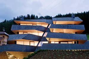 Dolomitenblick by Plasma Studio Slices Through Its Spanning Landscape