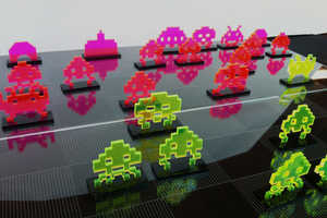The NMI Laser Team Develops This Vibrant Space Invaders Chess Set