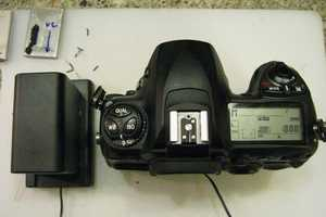 Make Your DSLR Last Five Times Longer with a Little Battery Hacking