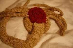 This Knitted Alien Facehugger Mask Will Keep You Skeptically Warm