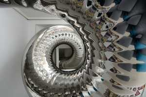 This NYC Penthouse Has a Four-Storey Tall, Coiled Slide as an Exit