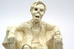 The Zombie Lincoln Resin Coin Bank is Historically Mortifying
